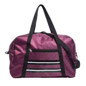 Handbags - NWT Burgundy Red Varsity Weekender Bag